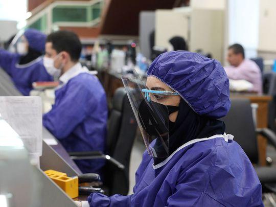 Bank-employees-wear-protective-face-masks-_170e8d84126_medium